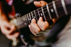 how to learn to play guitar in one week?